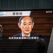 A screen in Tokyo broadcasts Japanese Prime Minister Yoshihide Suga's resignation announcement on Sept. 3, 2021.