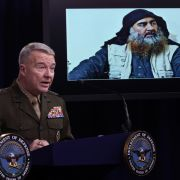 U.S. Marine Corps Gen. Kenneth McKenzie speaks as a picture of Abu Bakr al-Baghdadi is seen during a press briefing Oct. 30, 2019, at the Pentagon in Arlington, Virginia.