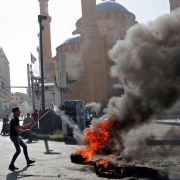 Demonstrators burn tires in Lebanon's capital of Beirut on June 26, 2021, in protest of the country's ongoing economical and political crisis.