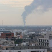 Smoke billows after an attack by Libyan National Army leader Khalifa Hifter on Tripoli on Jan. 19, 2019.