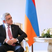 Russian President Vladimir Putin (R) mediated the latest round of talks between Armenian leader Serzh Sarkisian (L) and Azerbaijani President Ilham Aliyev on June 20 in St. Petersburg. The three met to discuss an end to the Nagorno-Karabakh conflict.
