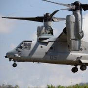 The hallmark of the V-22 Osprey's design is twin tilt rotors suspended at the ends of a central fixed wing.