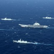 A Chinese navy formation, including the aircraft carrier Liaoning (C), steams ahead during military drills in the South China Sea early in 2017.