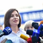 Moldovan President Maia Sandu speaks with journalists outside a polling station in Chisinau on July 11, 2021.