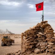 A bulldozer passes by a hilltop manned by Moroccan soldiers in Western Sahara on Nov. 23, 2020.