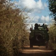 Army vehicles patrol the roads on the outskirts of a village in northern Mozambique on May 26, 2016.