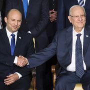 Israeli President Reuven Rivlin shakes hands with Prime Minister Naftali Bennett during the official swearing-in of Israel's new government on June 14, 2021.