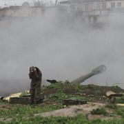 Armenian soldiers fire artillery shells toward Azeri forces in the town of Martakert, located in the disputed Nagorno-Karabakh region, on April 3, 2016.