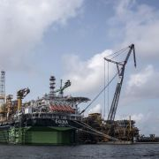 A photo shows the Egina FPSO (Floating Production Storage and Offloading) unit berthed at a harbor in Lagos, Nigeria.