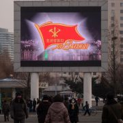 A news broadcast on a public television screen shows coverage of the 8th Congress of the Workers' Party of Korea in the North Korean capital of Pyongyang on Jan.11, 2021.