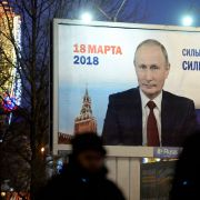 "A billboard with an image of Russian President Vladimir Putin reads ""Strong president - Strong Russia"" in St. Petersburg on Jan. 12, 2018."