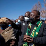 South African President Cyril Ramaphosa (center) visits a mall in Soweto that was damaged by looters on July 18, 2021.