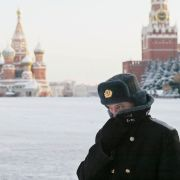 A Russian police officer patrols Red Square in the bitter cold of Russian winter.