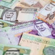 A collection of Saudi riyal banknotes.