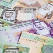 A collection of Saudi riyal banknotes.