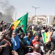 Protesters gather in the Senegalese capital of Dakar on March 8, 2021, after the country's opposition leader Ousmane Sonko was charged with rape.