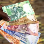 A man holds new South African banknotes of the South African rand on July 13, 2018, in Pretoria, South Africa.