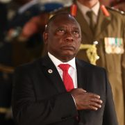 South African President Cyril Ramaphosa stands during the national anthem before delivering his annual State of the Nation address to parliament in Cape Town on June 20, 2019.