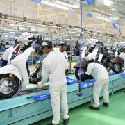 Employees assemble parts and make final inspections of Honda Activa scooters in Narasapura, on the outskirts of Bangalore, India.