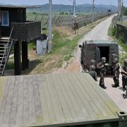 South Korean soldiers gather near a guard post in the border city of Paju, South Korea, on June 17, 2020.