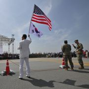 A man waves U.S. and South Korean flags during a ceremony in Pyeongtaek, South Korea, on June 8, 2019.