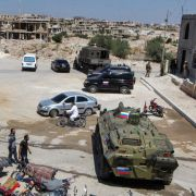 Russian military vehicles are seen in the southern Syrian city of Daraa on Sept. 6, 2021.