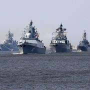 Russian navy ships, among them the Russian frigate Admiral Gorshkov, second from left, sail near Kronshtadt naval base outside St. Petersburg on July 20, 2018.
