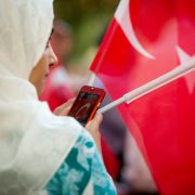 A woman shares a photo of the Turkish flag on social media during a protest in Washington D.C. on July 15, 2016.