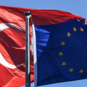 The Turkish flag (left) waves alongside the EU flag in Istanbul in August 2018.