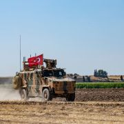 In this photo taken on Sept. 24, 2019, a Turkish military vehicle participates in a joint patrol with the United States near the Syrian border with Turkey. The joint patrols were aimed at easing tensions between Turkey and U.S.-backed Kurdish forces.