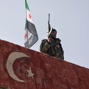 A Turkish-backed fighter guards the rebel-held province of Aleppo in northern Syria on Nov. 17, 2020.