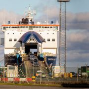 Vehicles drive off a ferry at the Port of Larne in Northern Ireland on Dec. 6, 2020. The port, which handles travel and freight from Scotland, is expected to be building a new Border Control Post (BCP) as a consequence of Brexit.