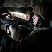 Ukrainian servicemen stand in position on the front line with Russia-backed separatists Feb. 19, 2021, in the Donetsk region.