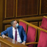 Ukraine's new central bank chief, Kyrylo Shevchenko, wears a face mask as he watches lawmakers vote on his candidacy during a parliamentary session on July 16, 2020.