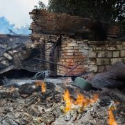 A house in the village of Roza in eastern Ukraine is left burning after fighting between Ukrainian forces and Russian separatists on Sept. 6, 2019.