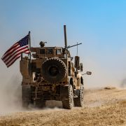 A U.S. military convoy patrols a Syrian village along the Turkish border on Sept. 8, 2019.
