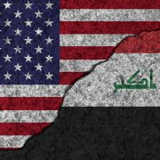 An image of cracked, painted picture of the U.S. and Iraqi flags illustrates the two countries' decaying relationship due to Washington's ongoing pressure campaign and proxy battle against Iran.