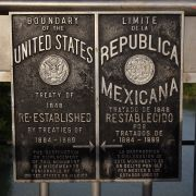 Signs mark the boundary between the United States and Mexico over the Rio Grande on Aug. 6, 2008, near Laredo, Texas.