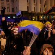 People gather outside the presidential office in Kyiv on Dec. 9, 2019, as they wait for news of talks held in Paris to try to end the conflict in eastern Ukraine.